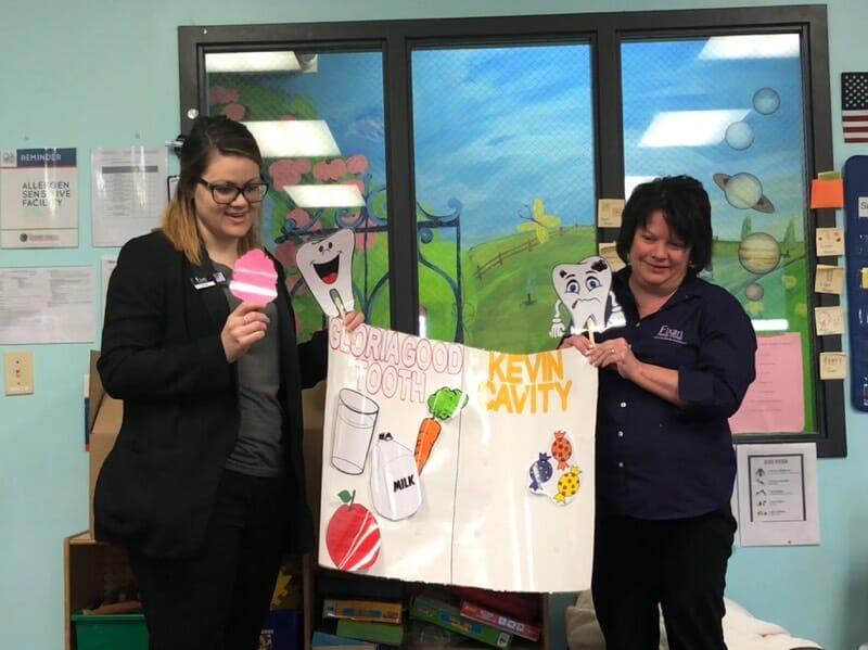 staff teaching children about dental care