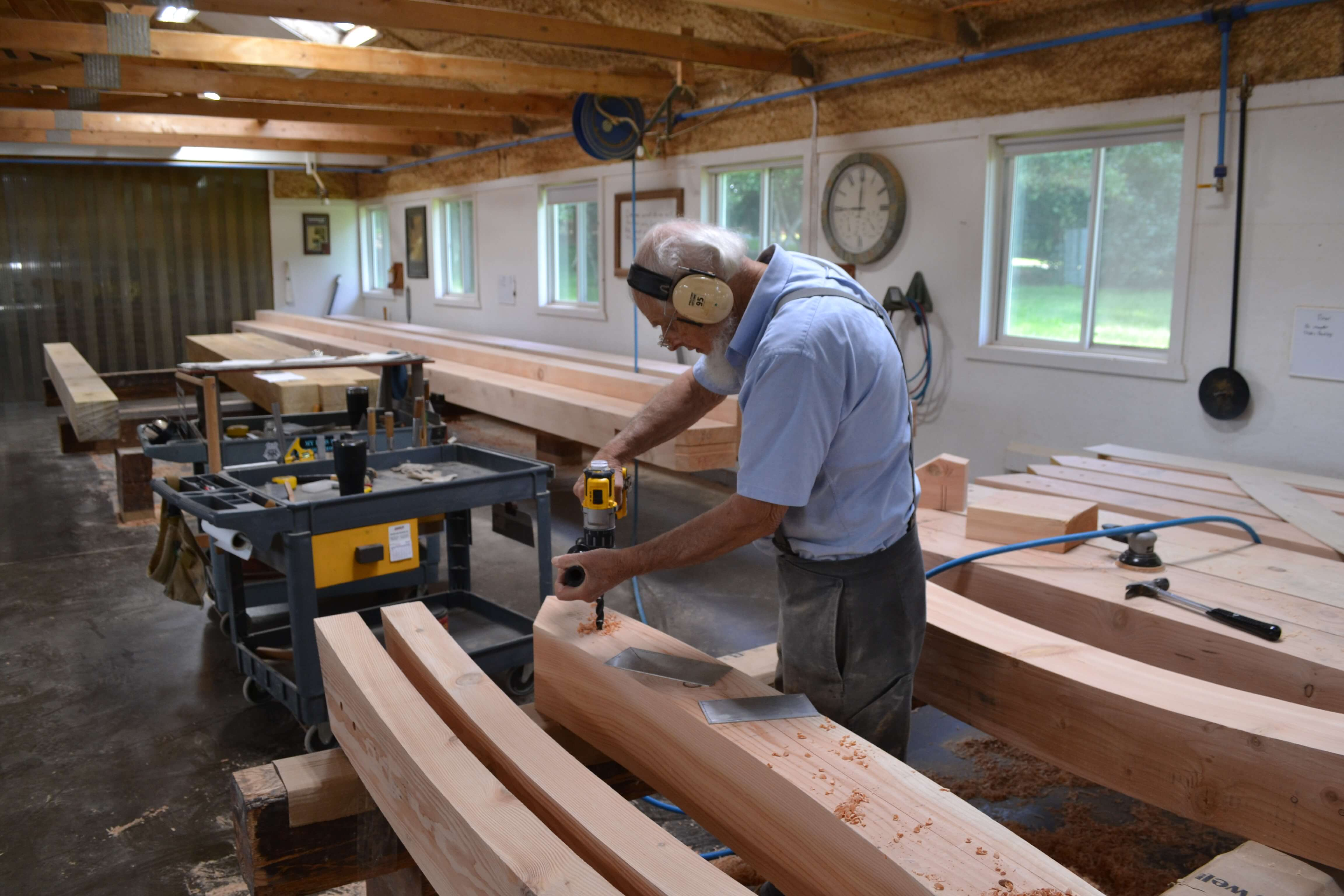 Amish craftsman build beams for the entrance to Fixari Family Dental of Lewis Center